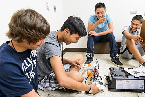 Middle school students construct robots using LEGO Mindstorm kits during a Precollege Enrichment Opportunity Program