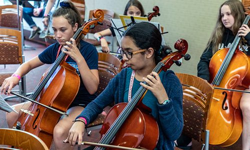 Summer Music Clinic students play strings in orchestra
