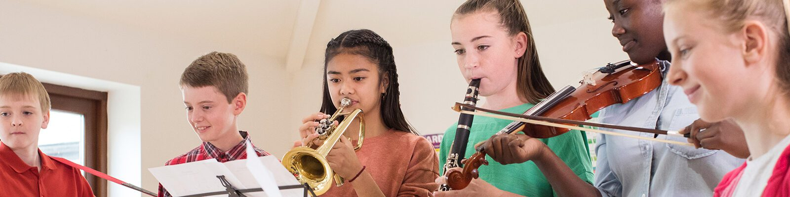 High School Students Playing In School Orchestra Together