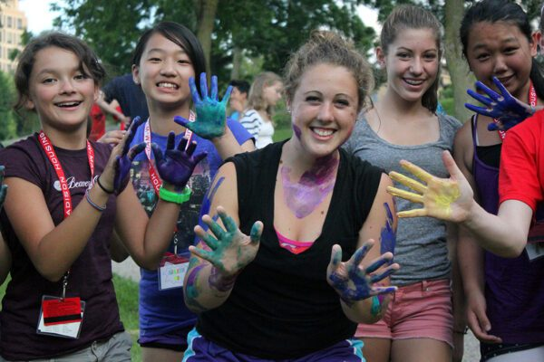 WCATY participants show of their hands after doing finger painting